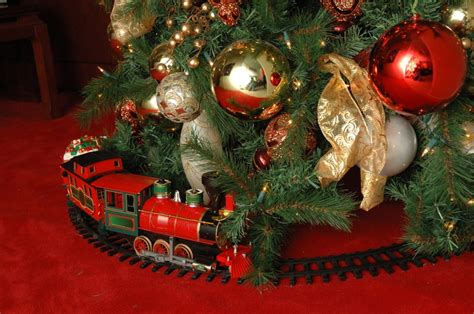 why do people put toy trains under christmas trees