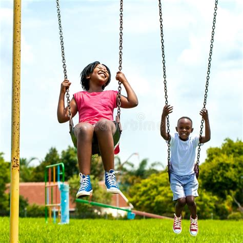 is swinging fun african kids having fun swinging in park stock photo