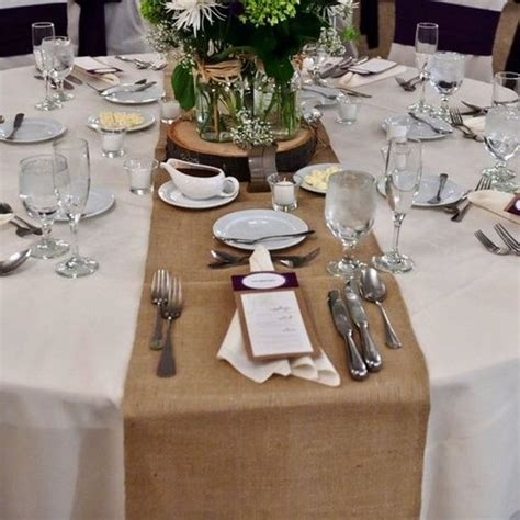 hessian table runner on table white table cloth and
