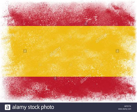 colors of spain powder paint exploding in colors of spain flag isolated on