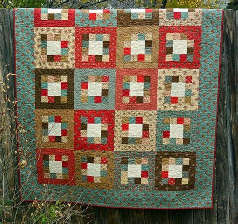 handmade quilt in teal and brown squares