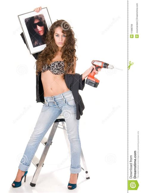 Decorator Interior bricolage woman with a picture to hung royalty free stock