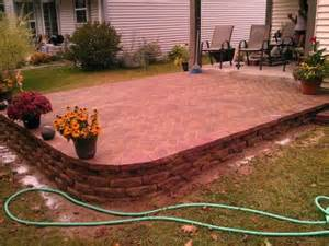 Decks Porches And Patios Slope For Patio With Retaining Wall Doityourself Com