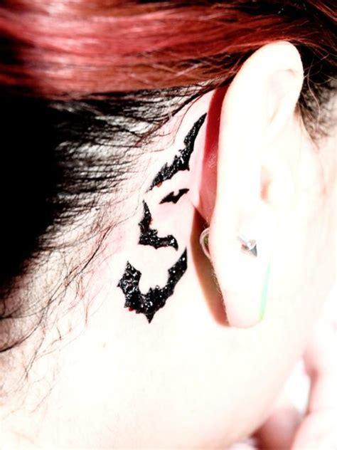 tattoo behind ear in military bats tattoo behind ear