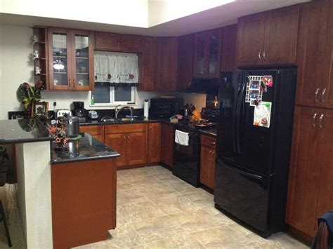 cherry cabinets with light granite countertops light cherry c c cabinets and granite
