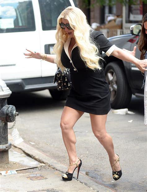 stumbles in 6 inch louboutin heels and minidress footwear news