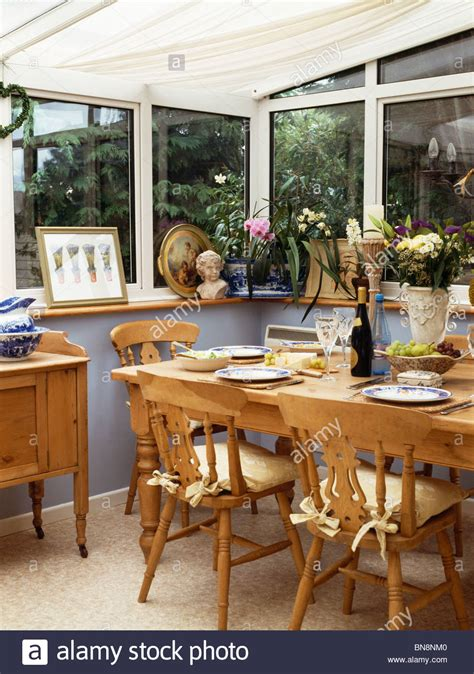 Conservatory Dining Table Wooden Chairs And Table In Small Conservatory Dining Room Stock Photo Royalty Free Image