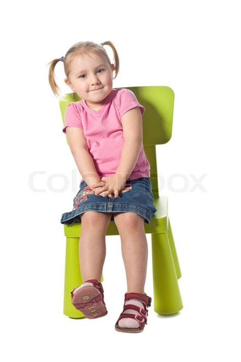 Sit On The by The Child Sits On A Chair Stock Photo Colourbox