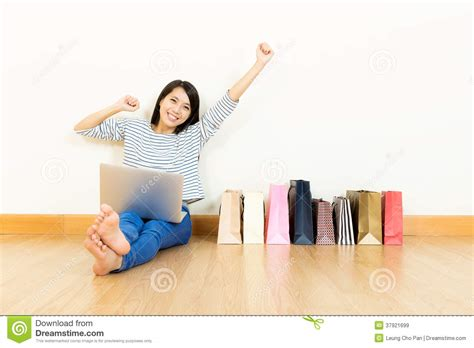 shopping home asian woman online shopping at home with assorted paper