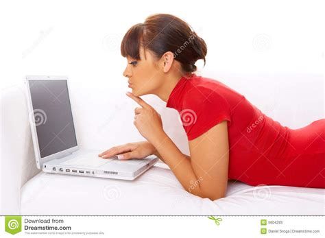 laptop on couch girl with laptop on couch stock photos image 5604293