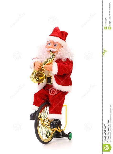 imagenes de santa claus en bicicleta santa claus toca el saxof 243 n en la bicicleta foto de