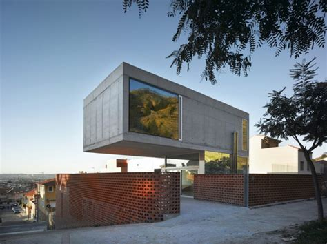 cantilevered concrete house eclectic design with mirrors