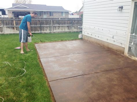 how to concrete backyard how to stain a concrete patio chris loves julia