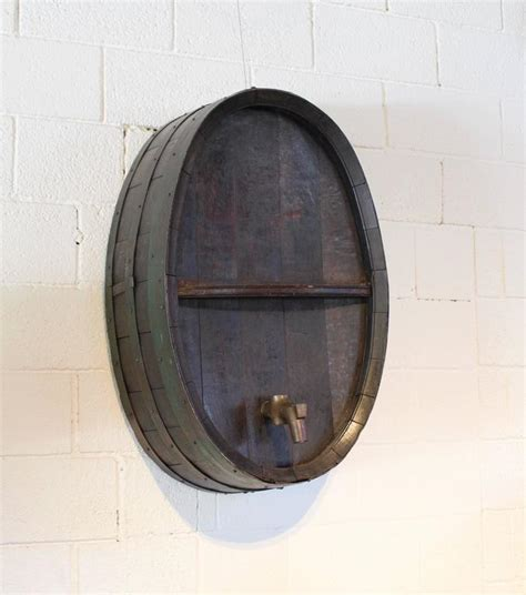 antique iron banded green wine barrel as wall decor
