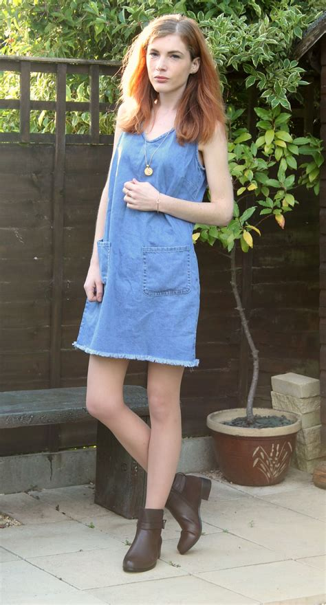 jean dress with boots denim dress and lunar boots a chain