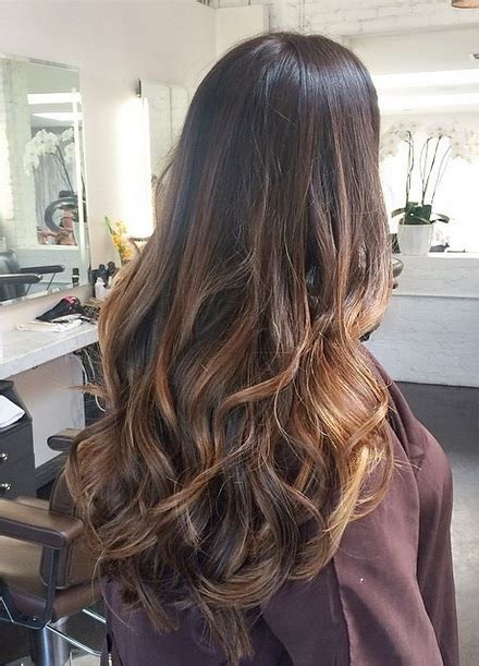 long hairstyles with color highlights brunette with caramel highlights neil george