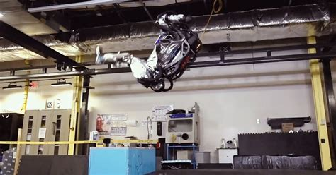 boston dynamics robot boston dynamics robot can now nail a backflip and land steadily on its virascoop