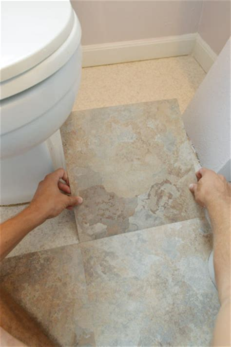 how to lay sticky tile in bathroom day two of our big bathroom makeover for