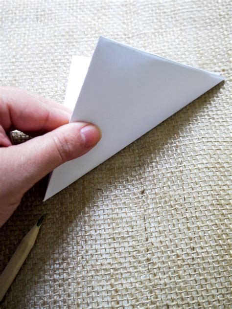 Fold Paper Into Triangle - how to make paper decorations hgtv