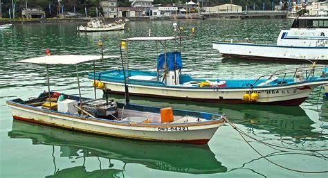 fishing boat in japan fishing boats okinawa japan photograph by jocelyn kahawai