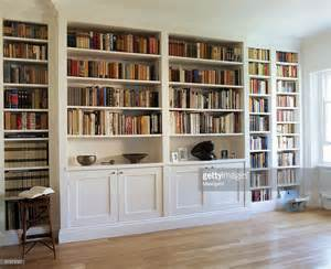 white builtin bookcase filled with books stock photo