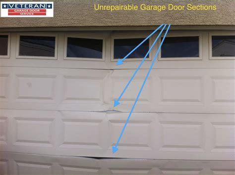 cost to fix garage door panel how to fix my garage door is it possible to fix a split
