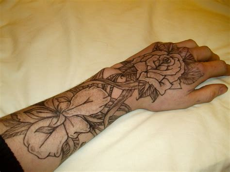 flower hand tattoo flower hand tattoo by josephblacktattoos on deviantart