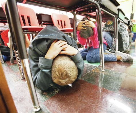 The Telegraph   AMS students shake out during earthquake drill