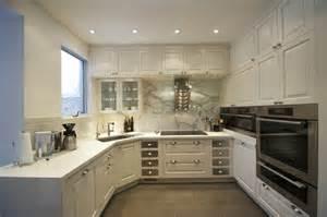 Kitchen u shaped kitchen design used white furniture in the white wall