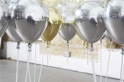 Suspended by Shiny Gold and Silver Balloons: UP Dining Table   Freshome.com