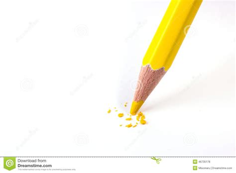 colors close to yellow close up of yellow color pencil head break stock photo