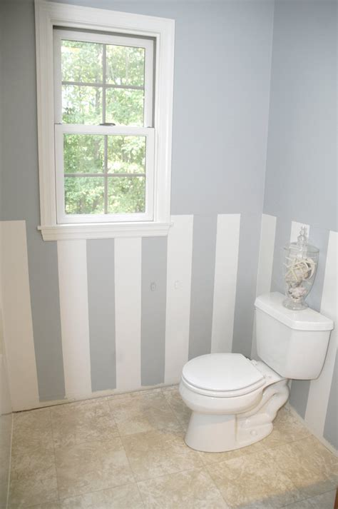 painting stripes in bathroom easy diy wall stripes in the bathroom living rich on