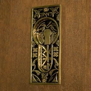 Butterfly recessed pocket door flush pull blackened brass hardware
