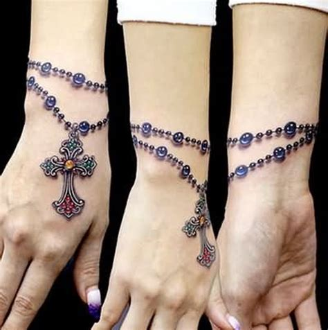 rosary tattoo around wrist 47 stylish cross tattoos for wrists