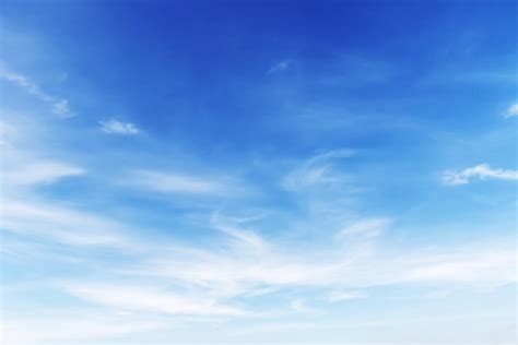 blue sky background fantastic soft white clouds against blue sky background