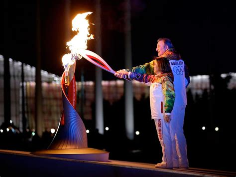 Lighting Olympic Torch by Sochi Winter Olympics Launch With Space Flown Torch