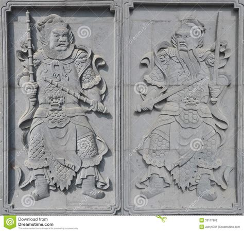 pair  brick carving door god stock photo image