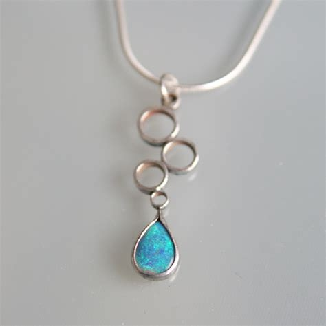adventures in silverland design of the week opal drop