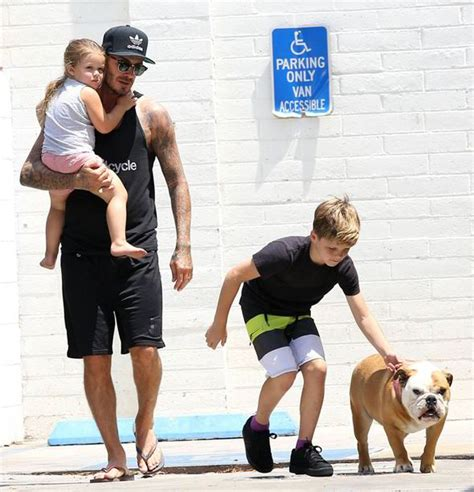 romeo beckham secondary school harper beckham clings to father david as they leave pooch