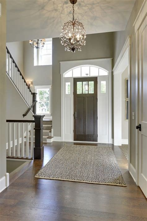 gorgeous entryway  high ceilings tall front door