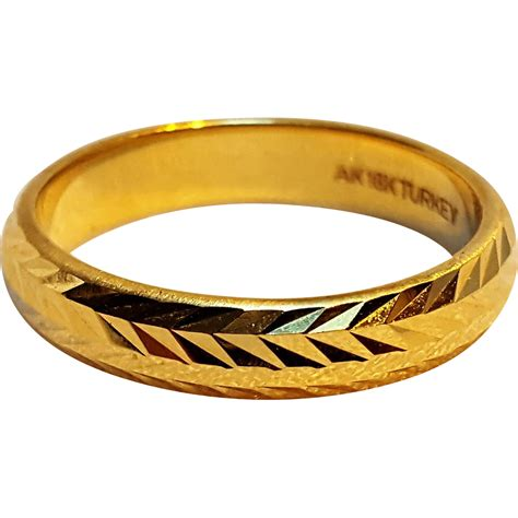 ring pattern in gold 18k gold band ring laser cut pattern from green mannequin