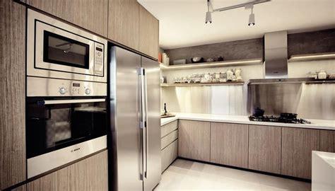 kitchen design consultant designing a sleek modern kitchen design consultant and