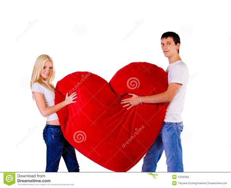 golden couple have big hearts young couple with a big red heart stock photography