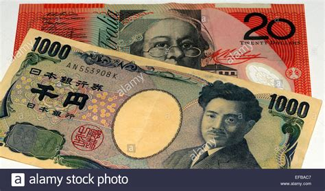 currency converter yen to aud australian dollar and japanese yen bank notes stock photo