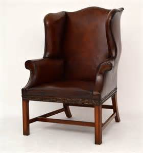 leather wing armchair pair of antique distressed leather wing armchairs