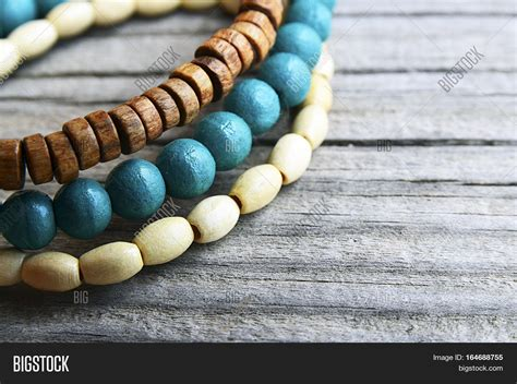 Handmade Wooden Bracelets - colorful wooden bracelets on wooden background
