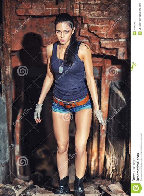 Hot Movie Themes | sexy soldier woman on factory ruins stock photo image