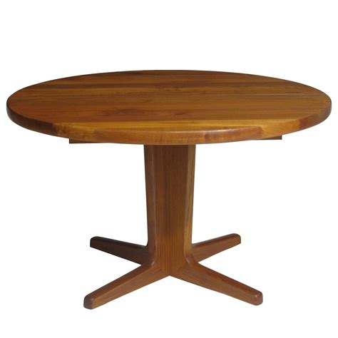 Solid Teak Dining Table Solid Teak Dining Table With Two Leaves For Sale At 1stdibs