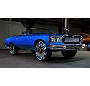 Blue Chevy Donk Convertible With A Custom Chrome Grill On