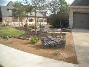front yard landscape xeriscape theme with decomposed granite mulch a dry creek bed and